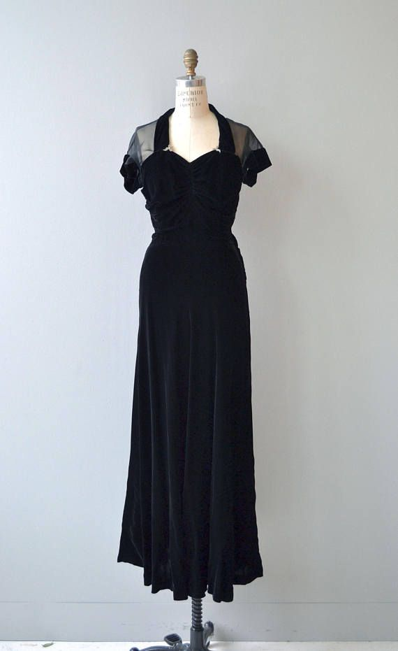Vintage 1930s jet black silk velvet dress with fetching sweetheart neckline, black sheer net shoulder, sleeves and upper back, fitted waist, small paste rhinestone bow details at the neckline, long sweeping skirt and side metal zipper.  --- M E A S U R E M E N T S ---  fits like: medium