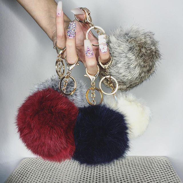 Fur pom pom keyring {use to dangle on bags}; Missguided- Faux Fur Pom Pom Keyring in Grey, Black (for key chain) & Nude & Fluffy pom pom keyring in cream / Lamoda White one - http://www.lamoda.co.uk/shake-it-like-a-pom-pom-white-keyring