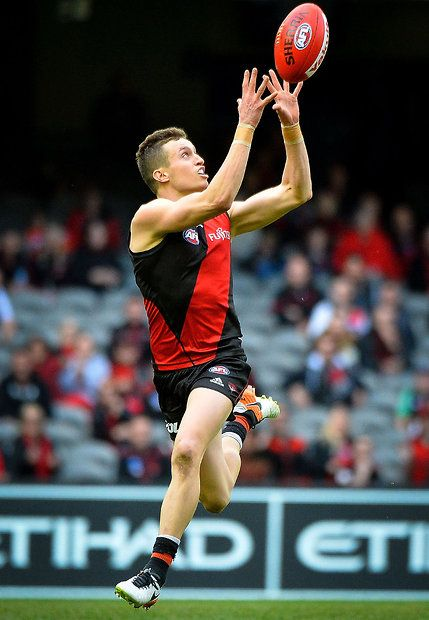 MELBOURNE, AUSTRALIA - AUGUST 14: Orazio Fantasia of the Bombers marks the ball during the 2016 AFL Round 21 match between the Essendon Bombers and the Gold Coast Suns at Etihad Stadium on August 14, 2016 in Melbourne, Australia. (Photo by Dylan Burns/AFL Media)