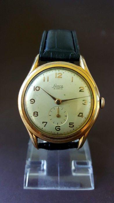 Lanco Swiss made - Herenhorloge - Jaren 60  Zeer aparte en goed bewaard gebleven dresswatch uit de jaren 60 van het beroemde Zwitserse merk Lanco.Met een zeer net uurwerk zie foto.Dit voor die periode zeer grootte en dunne horloge is in een nette staat.Met een mooie wijzerplaat en kast.Kleine seconden wijzer bij het 6e uur.Zeer groot voor die periode 38 mm zonder de kroon.Mooi dun 6/7 mm.Lengte van het bandje is ongeveer 23 cm.Echt een stijlvolle dresswatch uit de jaren 60 die vooral door…