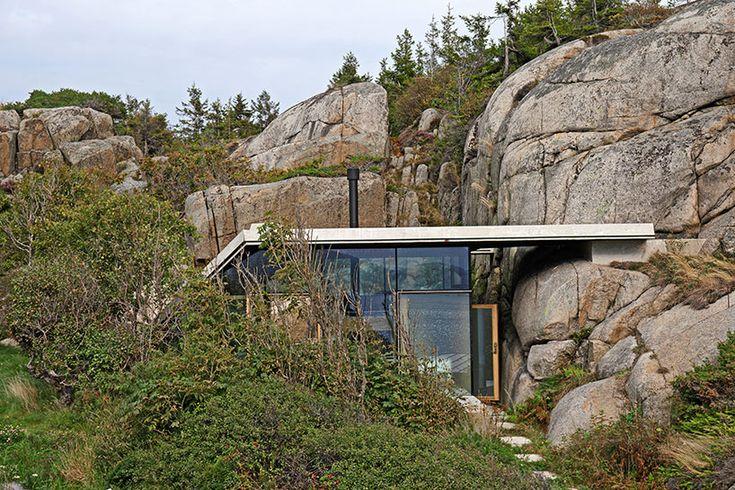 lund hagem constructs cabin knapphullet in natural rock formation
