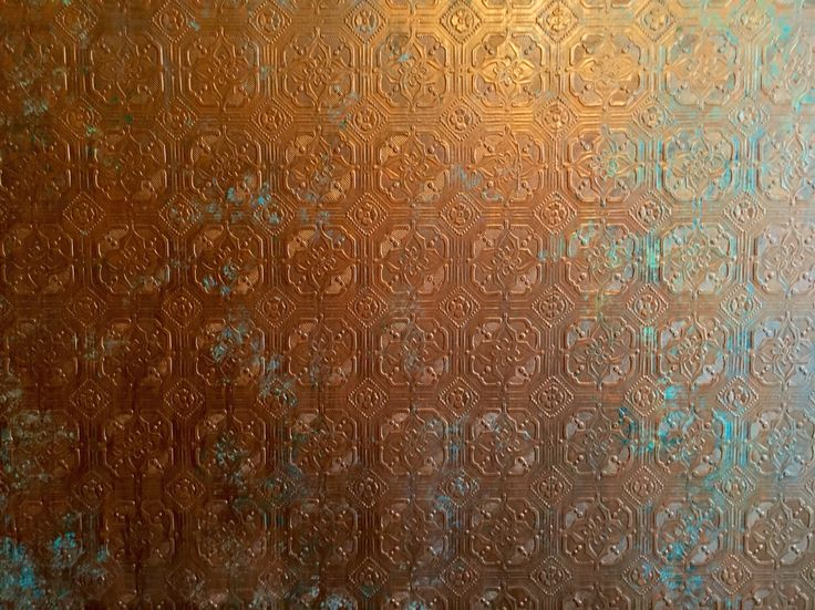 Anaglypta wallpaper, painted to resemble copper with a verdigris patina, for my steampunk bathroom.