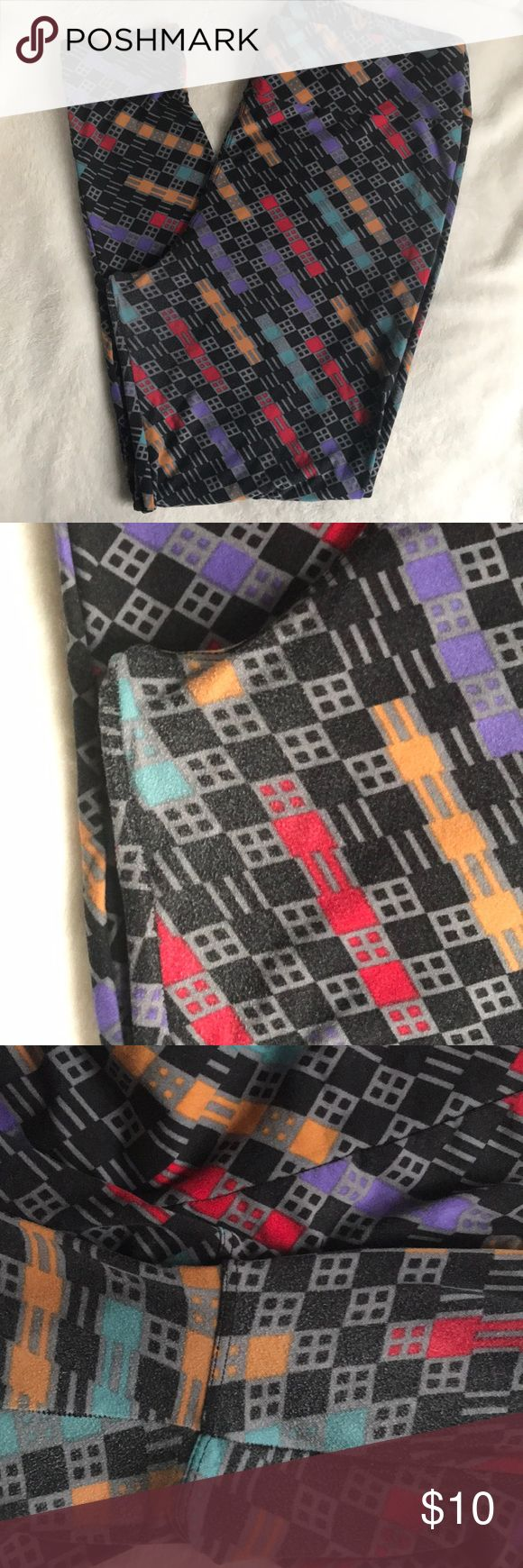 TC LuLaRoe leggings TC LuLaRoe leggings black background with gray, red, purple, mustard, and aqua design...worn once has some piling where thighs rub....NO HOLES Washed once per Lularoe instructions LuLaRoe Pants Leggings