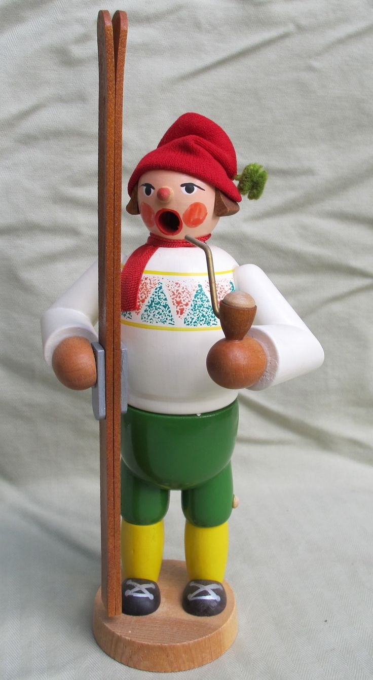 A more modern smoker, this skier is wearing a knitted hat.  He is smoking a pipe, the incense smoke comes out his mouth.