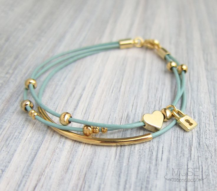 Gold Charm Leather Bracelet - Layered Bracelet, Gold Bar Bracelet, Multi Strand, Pastel Blue Cord, Stacked Bracelet - Heart and Lock. $23.00, via Etsy.