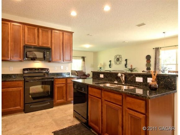 Dark Granite Wood Cabinets And Black Appliances Click The Pin For More