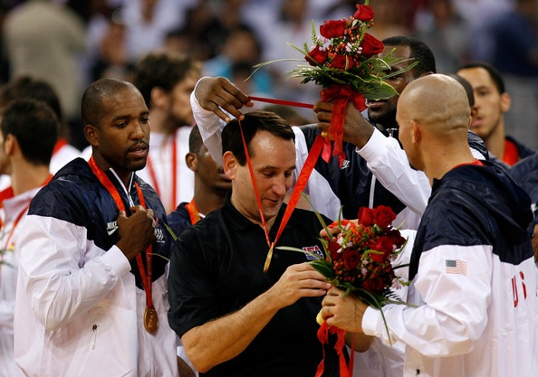 Head coach Mike Krzyzewski of the United States receives a gold medal from a player after the United States defeated Spain in the gold medal game during Day 16 of the Beijing 2008 Olympic Games at the Beijing Olympic Basketball Gymnasium on August 24, 2008 in Beijing, China.