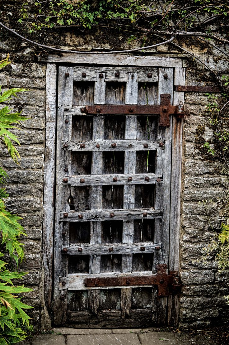 Haddon Hall | Old door supported by wrought iron T hinges.