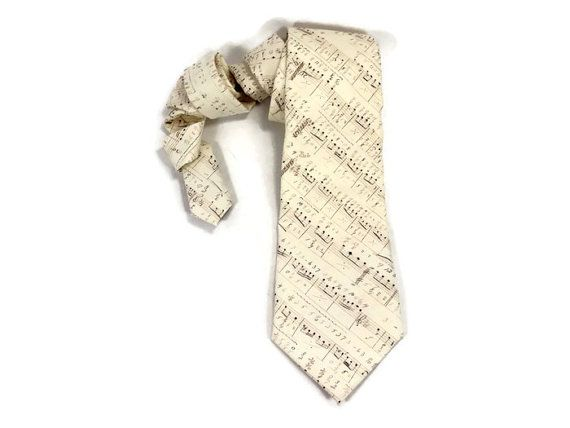 Brown and cream antique music notes.  Your tie will be cut at on the bias, ensuring a proper twist and give when its tied. It will be lined with a