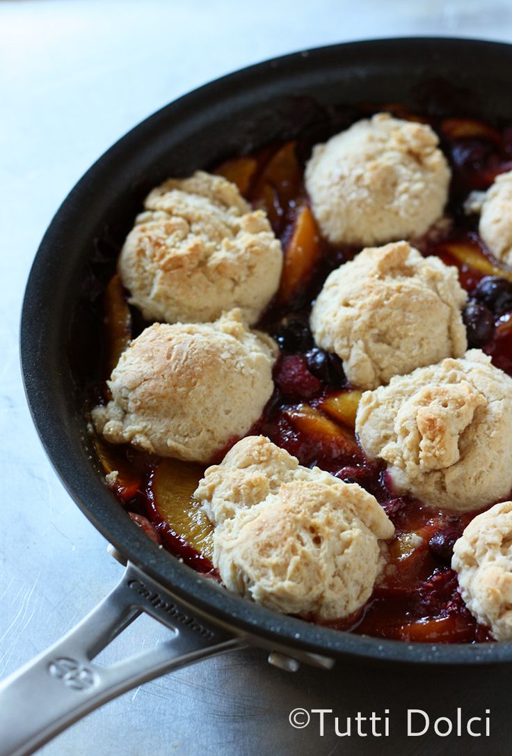 Grilled Skillet Cobbler, simple yet satisfying fruit cobbler topped with brown butter biscuit dough, cooked on the grill