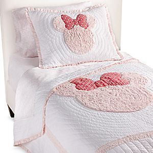 Minnie Mouse Really Ruffle Quilt by Ethan Allen | Disney Store Minnie Mouse gets her head down on this 100% cotton voile quilt in oh-so-soft pink. With its delicate hand-stitching, precise ribbon ruching, embroidered bow appliqué, cotton fill, and ruffles galore, it's a dream!