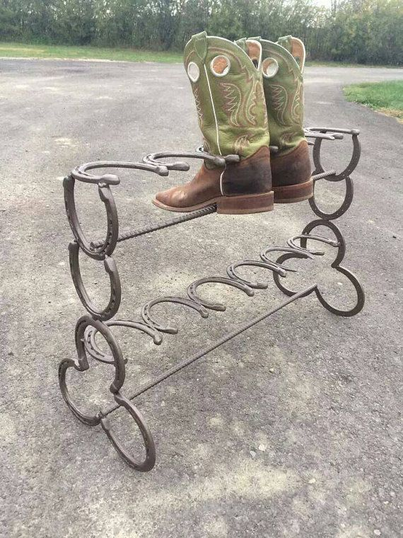 organize your boot collection with this clever boot rack made from horseshoes