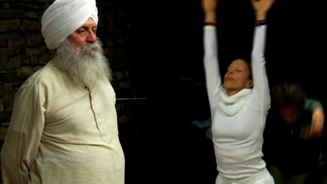 Enjoy this elevating Kundalini Live class with guest teacher Sat Santokh Singh. Kundalini Live is a weekly high vibration kundalini yoga practice. There are no actors or scripts. Kundalini Live is filmed and broadcast live at Wave Street Studios on the Monterey Peninsula. .Sat Santokh leads an advanced level class that empowers us to identify and remove some of the road blocks we've built for ourselves from the journey ahead. Tune in Wednesday at KundaliniLive.com at 7pm PST for our free…