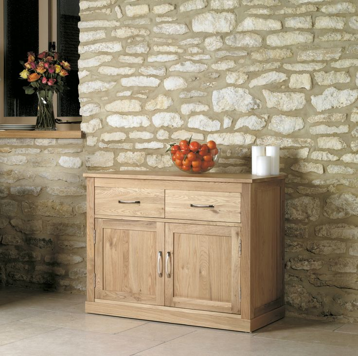 Superb contemporary small oak sideboard  The overall dimensions of the sideboard are H75 x W100 x D46 cm  One large cupboard features an adjustable (3 position) shelf for versatlie storage  The internal dimensions of both shelves are: