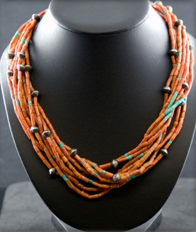 his is a authentic old Mediterranean Coral Necklace that has been tucked away in a collection from Durango, Colorado for over 70 years. It was most likely made by a member of the Santo Domingo Indians between 1920 -1940. The Coral is beautiful with many shapes and color variations which made this piece very attractive. It was stung with handmade Silver beads and accented with Blue Turquoise beads as well