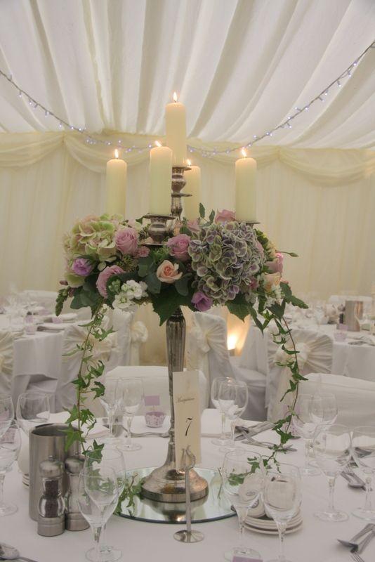 Best 25 candelabra flowers ideas on pinterest for Wedding reception centrepieces