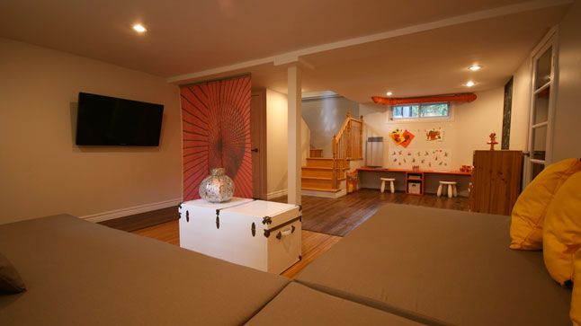 Un espace pour les enfants et les parents au sous-sol... Une autre transformation réalisée par l'équipe de Style France Arcand