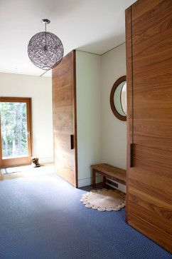 8 Ideas for High-Functioning Mudrooms   Neat and clean. - Not all of us like to have our jackets and coats on display. These floor-to-ceiling cabinet doors keep clutter out of sight and add an architectural statement.
