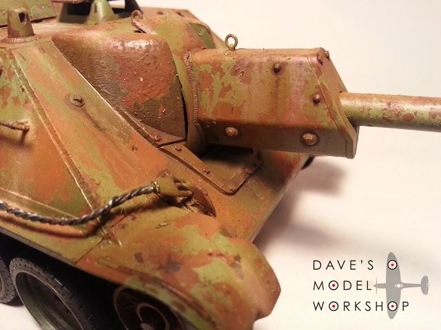 Weathering a model tank with oils and acrylic paints.