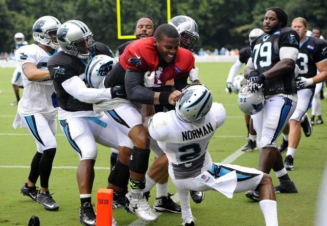 Carolina Panthers' Cam Newton (1) and Josh Norman (24) have to be separated after a skirmish in practice during Carolina Panthers Training Camp at Wofford College in Spartanburg, SC on Monday.