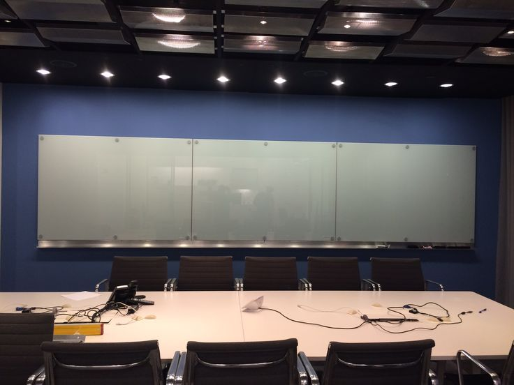 Beautifully innovative Krystal Glass white boards in corporate conference room.
