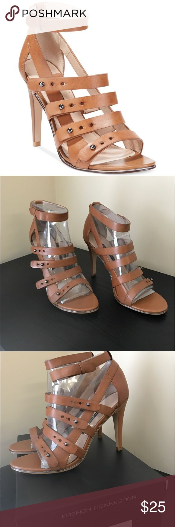 NWOT French Connection Caged Heels Dressy sandals featuring four straps with metallic push through notches. Heels are 100% leather and NEVER WORN, with box. Although they are a European size 41M, I would say they fit like a 10US sized heel. Super sexy and comfortable! French Connection Shoes Heels