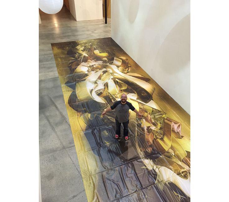 Praca Tomasza Opasińskiego z cyklu Experimental Art wydrukowana jako pełnorozmiarowy billboard. Zdjęcie zrobione w siedzibie w agencji Ignition Creative, w której pracuje (archiwum prywatne)
