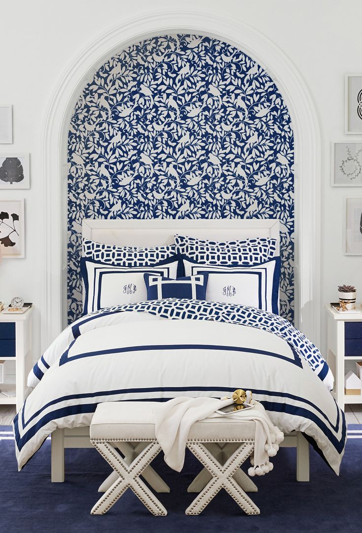 This classic navy and white bedroom gives us the blues (in a good way). Create a chic and sophisticated girls room with mix-and-match patterns.