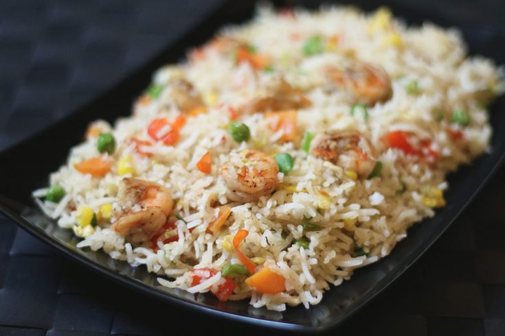 Prawn Fried Rice is a Perfect Meal as it has low fat, but protein rich Prawns and Eggs as well as having a combination of nutritious veggies!