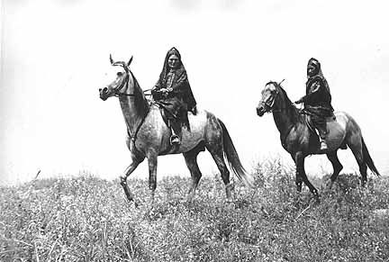 Turkmen women on horseback.