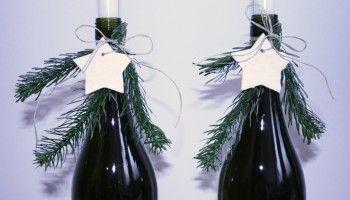 Kandelaars van wijnflessen