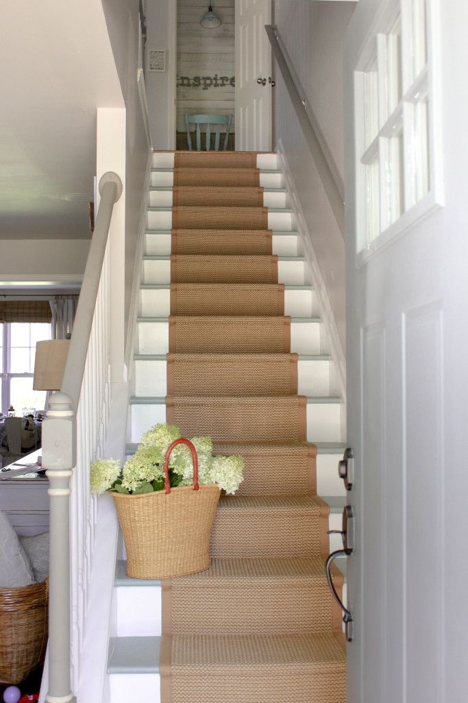 A stair runner make to look like sisal or natural fiber but holds up better to the elements