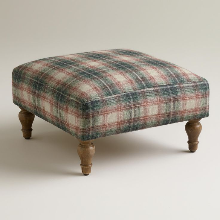 Plaid Hendrik Footstool | Crafted of mango wood, our delightful Plaid Hendrik Footstool is upholstered with cozy wool blend fabric in a gray and wine-hued plaid design. Whitewashed turned legs give this handsome piece even more sophisticated appeal. ($69.99)