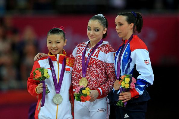 He Kexin of China, Aliya Mustafina of Russia and Elizabeth Tweddle of Great Britain - Uneven Bars