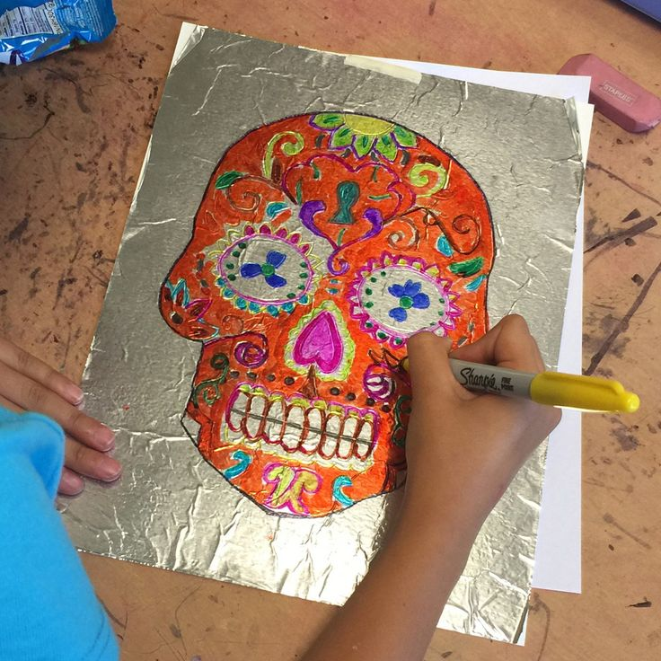 To make some super Day of the Dead Sharpie art, try coloring on aluminum foil. Colors just glide on and the foil adds a richness to the color.