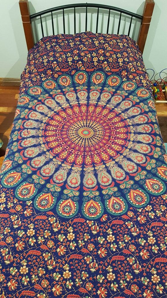 STUNNING for those who love mandalas , this is the quilt for you. We took an Indian Cotton sheet and transformed it to a beautiful warm quilt. One to be treasured. Navy along with earth tones is the majority of the quilt,  we placed a burgundy backing on it, to make the Earth tones pop. This quilt has been hand quilted. One of a kind. machine washable , line dry , no bleach or bleach like products, wash in cold water.  We will be having more mandala style quilts in the near future. Keep…