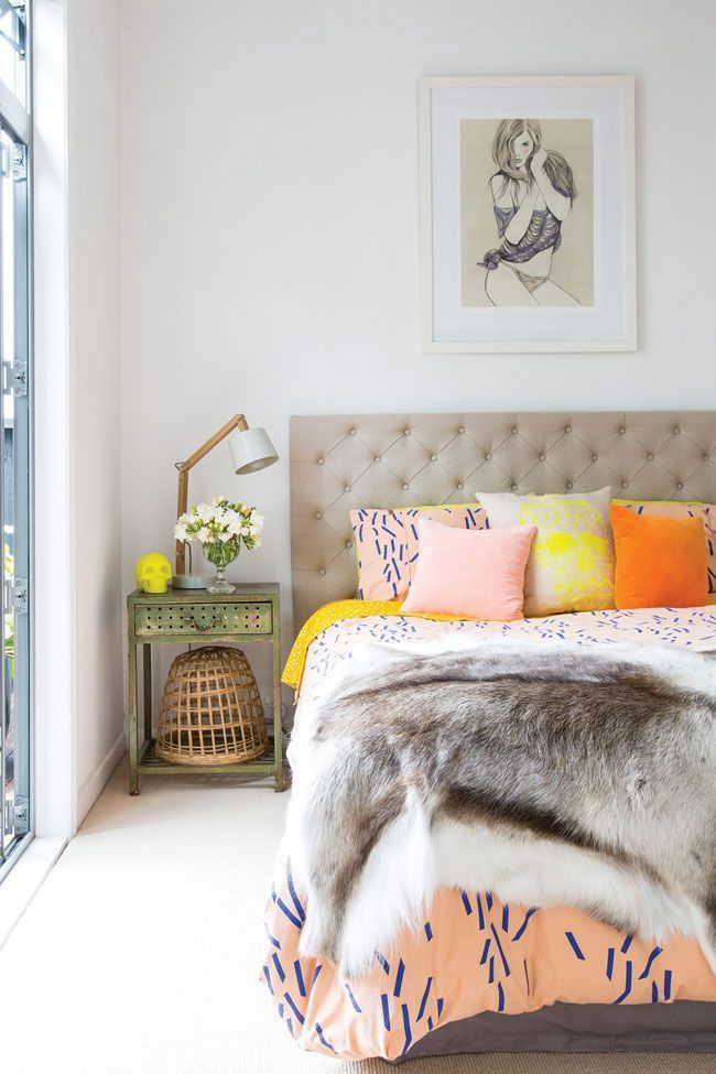 Brighten your bedroom with bright pastel pillows and antique furniture!