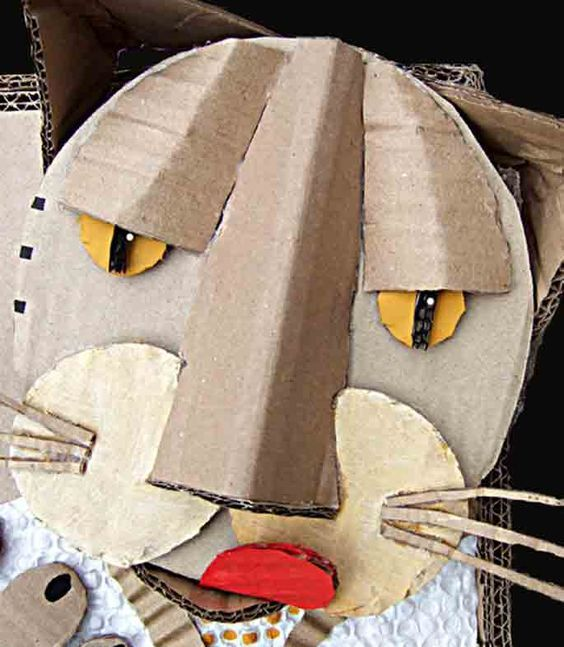 This artist makes faces and animal sculptures using cardboard!: