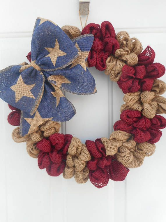 This is a handcrafted one of a kind wreath that Ive created using a 14 wreath form and generously looping alternating burgundy and tan burlap around it resulting in the final dimensions being approximately 16. Ive then added a wide (4) navy star printed ribbon bow for accent. This