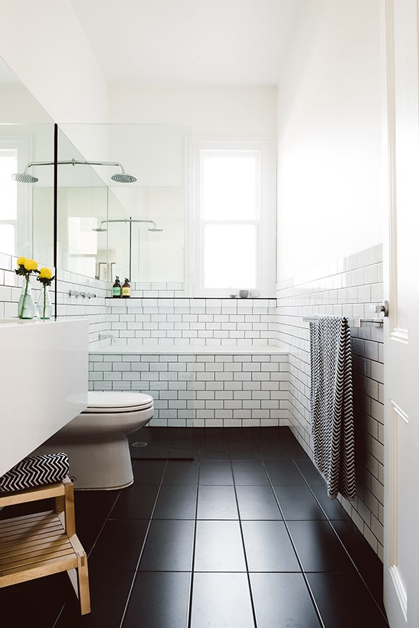 dark floor with 12x24 tiles and white brick pattern in the shower/bath area - love!