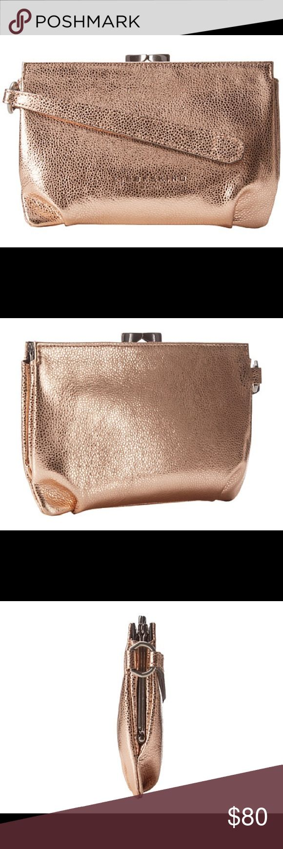 """Liebeskind® Patsy Clutch in copper, NWT! Add a shining touch to your evening attire with the Liebeskind® Patsy bag in metallic copper. Great for use as a pouch or make up organizer too!  Brand New with Tags.  Dust cover included.  100% Soft Calf Leather, Imported, Synthetic lining, Clasp closure, 5"""" high x 7"""" wide x 1.5""""  deep, Pouch with main compartment and wristlet strap, Signature logo detail in front. Liebeskind Bags Clutches & Wristlets"""