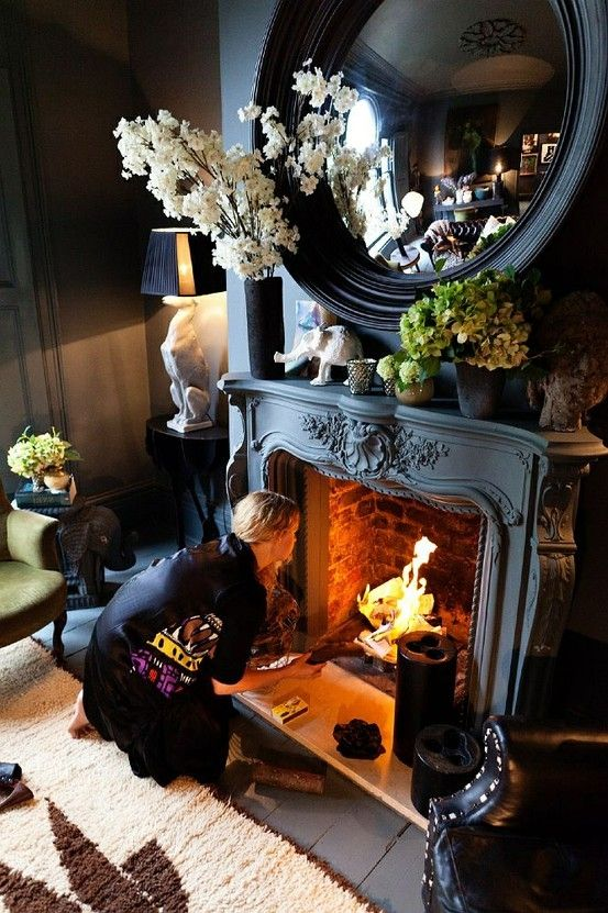 Fireplace and mirror.