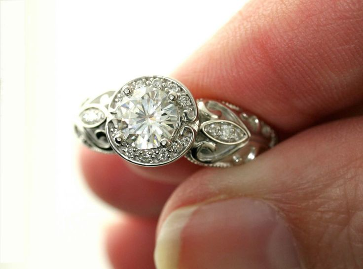 So classic... 14K Vintage Moissanite Engagement Ring Diamond Halo by RareEarth. $1,160.00 USD, via Etsy.