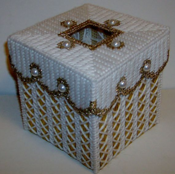 Treat yourself like royalty with the rich patterned elegance of this jewel-studded tissue topper. Can be done in any color of your choice, just let me know. Has a lot of nice extras, Metallic gold yarn and ribbon. Finished off with 12 white pearl cabochons. Totally breath-taking! Fits