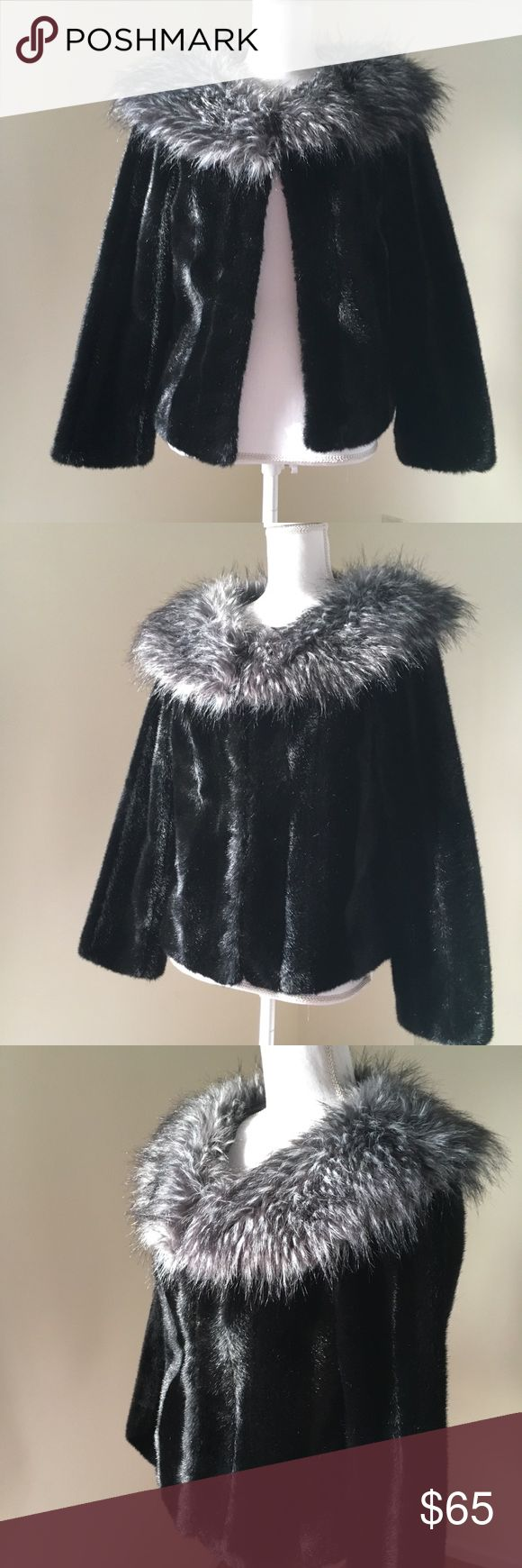 Nine West Black Faux Fur Cropped Cape Jacket Small Nine West Black Faux Fur Cropped Cape Jacket Small Black Faux Fur Cropped Jacket Gorgeous and soft Black Faux mink fur cropped jacket with contrasting Faux Fox fur collar, size small. By Nine West. Hook and Eye Closure. $149 🎀Search my closet for your size 🎀BUNDLE and SAVE! 🎀REASONABLE offers WELCOME 🎀NO TRADES NO HOLDS 🎀Thank you for stopping by!❤️ Nine West Jackets & Coats
