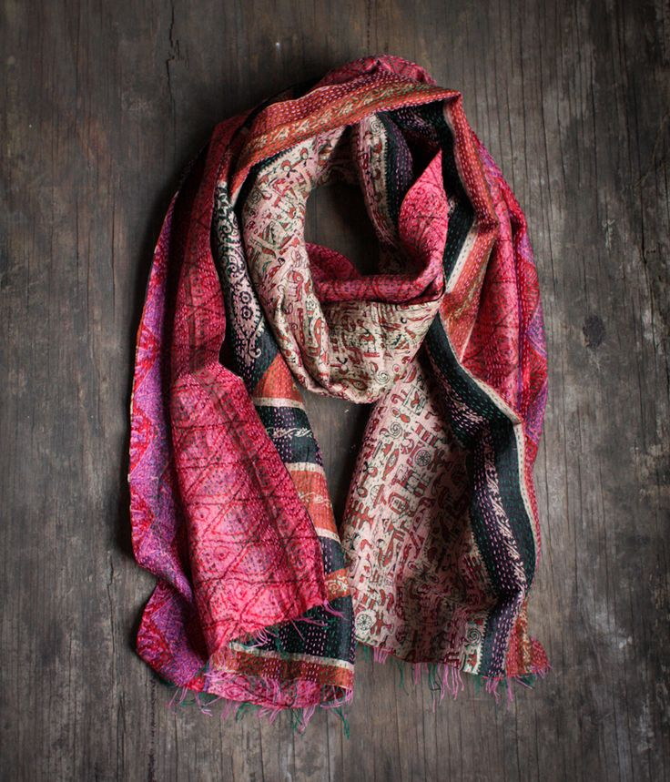 Say hello to India with this 100% silk scarf repurposed from vintage saris. This reversible kantha scarf features a running hand stitch that creates a unique texture and feel to this one-of-a-kind scarf.