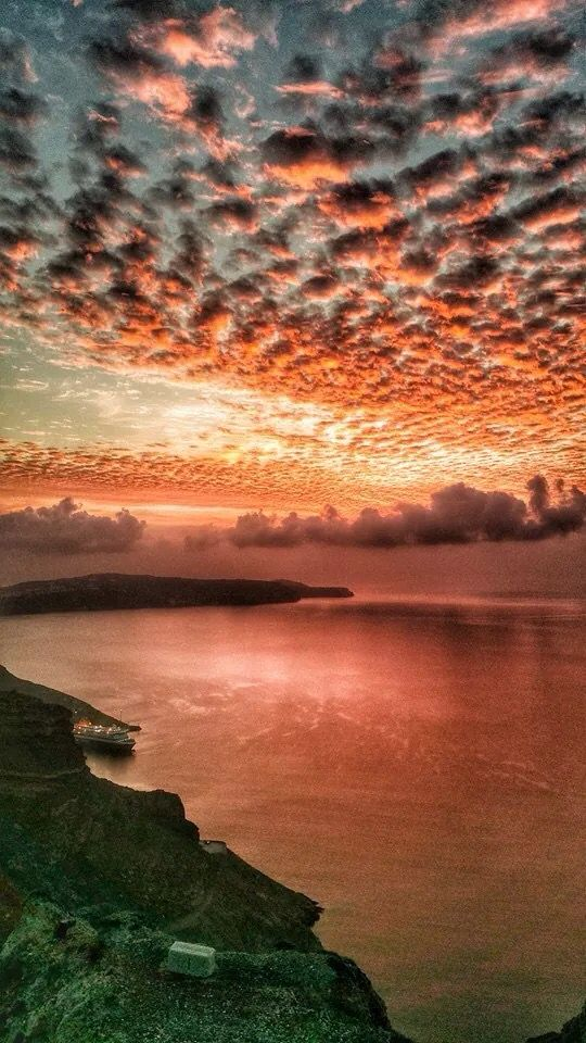 Sunset colors of amazing Santorini Greece even in winter