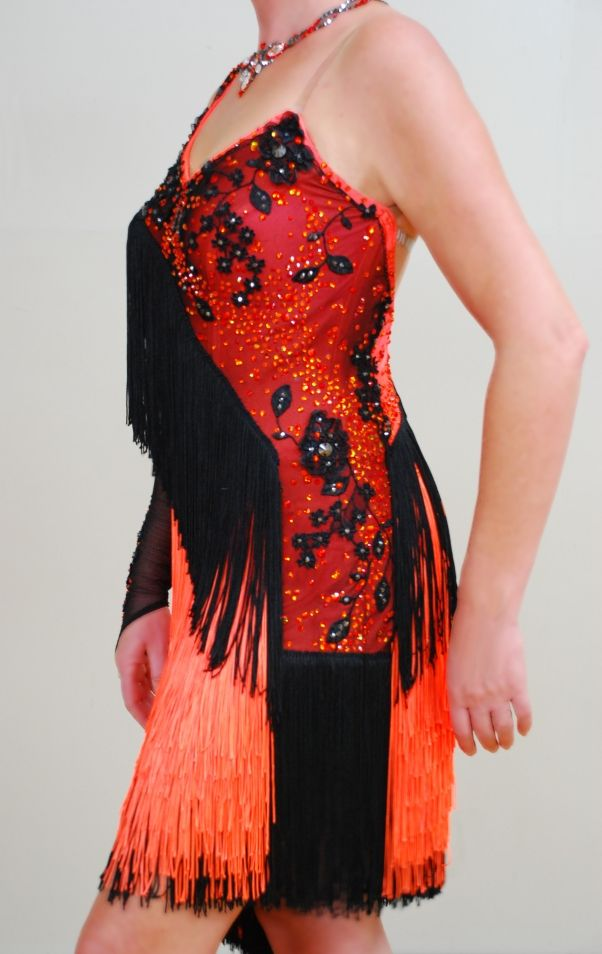 Latin dress.  Fluro orange fringe was sourced from Tennessee, once the dress was made I added the black lace and the over 4000 stones. Most stones are swarovski fire opal color.
