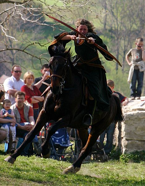 bow and arrow while on horseback
