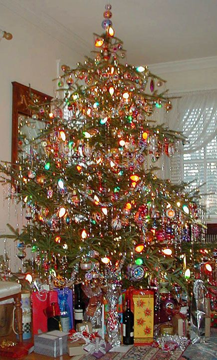 Love the big lights, the non perfect tree - brings back childhood memories! I always got to put on the tinsel!